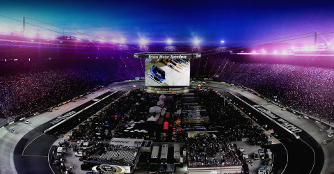 Shown is a concept depicting Bristol Motor Speedway's new Colossus video display. Featuring four custom-built screens each measuring 30 feet tall by 63 feet wide, Colossus will be the world's largest outdoor, center-hung video display. (Photo: Business Wire)