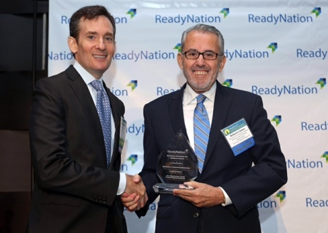 David Kass, CEO, Council for a Strong America, the nonprofit umbrella of ReadyNation, the preeminent business leader organization working to strengthen business through better policies for children and youth, presents Roberto Llamas, Executive Vice President of HR & Community Empowerment, Univision Communications Inc. with the Business Champion for Children Award to Univision Communications Inc.  (Photo: Business Wire)