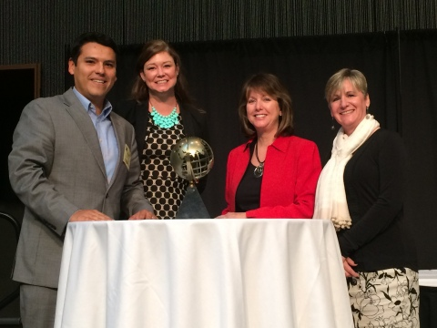 Manny Vasquez (left) and Beth Pritzl (second from left) of the Fox Cities Regional Partnership are presented with the IEDC 2015 Best in Show Award for Excellence in Economic Development by JoAnn Crary, chair of IEDC (second from right), and Karen Dickson, chair of the IEDC Awards Advisory Committee (right). (Photo: Business Wire)