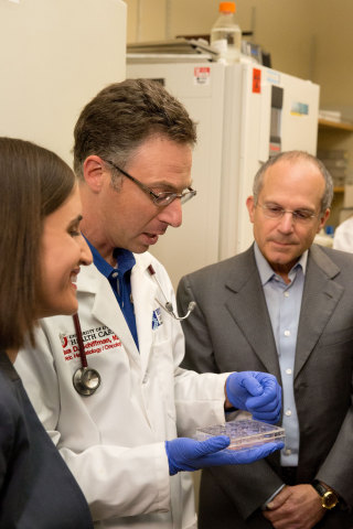 Juliette Feld, Executive Vice President of Feld Entertainment, learns more about cancer research and comparing the P53 gene from Dr. Joshua Schiffman, Pediatric Oncologist from Primary Children's Hospital and Investigator with Huntsman Cancer Institute, both located in Salt Lake City, UT, with Kenneth Feld, Chairman and CEO of Feld Entertainment, in Dr. Schiffman's lab at the Hunstman Cancer Institute.  (Photo: Feld Entertainment)
