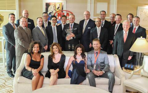 JM&A Group and KIA executives celebrate five years of partnership. (Photo: Business Wire)