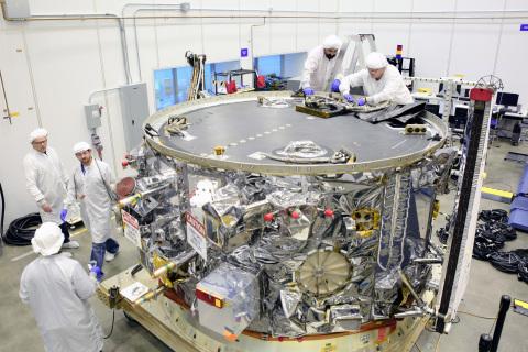 The OA-4 service module departs Orbital ATK's Satellite Manufacturing facility in Dulles, Virginia f ...