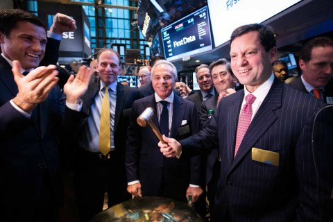 First Data Chairman and CEO Frank Bisignano strikes the NYSE First Trade Bell to celebrate the company's IPO on the NYSE. (Photo: NYSE)
