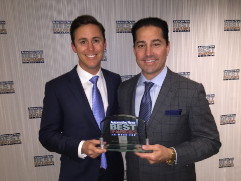 (Left to Right) indiGO Auto Group COO Kelly Wolf and CEO Todd Blue accept the Top 100 Automotive New ...