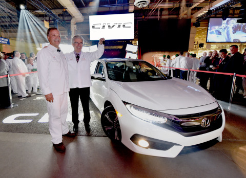 Dan Smith, president of Honda of Canada Mfg. (left) and Jerry Chenkin, president and CEO of Honda Canada Inc., celebrate the global start of mass production of the all-new 2016 Honda Civic sedan at Honda's production facility in Alliston, ON.