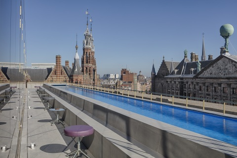 W Amsterdam features WET®, Amsterdam's first rooftop pool, offering views of the Royal Palace and li ...
