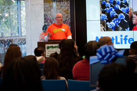 """MetLife Chief Technology Officer Jim O'Donnell welcomes students during the second annual """"MetLife Geek-A-Thon"""" where volunteers refurbished more than 400 computers for students in the North Carolina area. """"By providing children access to state-of-the-art computers we can inspire the next Steve Jobs or Bill Gates here in the Triangle,"""" said O'Donnell. (Photo: Business Wire)"""