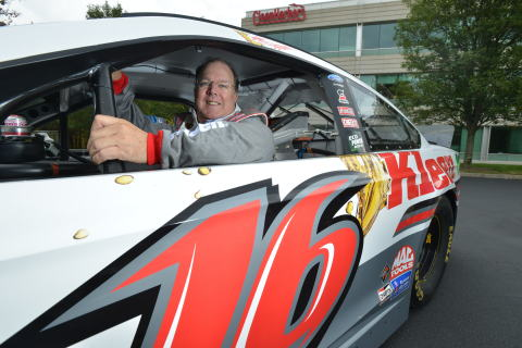 Clean Harbors CEO Alan McKim sits inside the Roush Fenway Racing #16 Sprint Cup NASCAR at Clean Harb ...