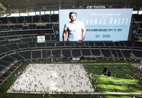 Singer Thomas Rhett and his fans take part in a huge TWISTER game on the World Record Breaking TWISTER mat which measures 27,159.616 square feet, at AT&T Stadium in Arlington, TX on Wednesday, September 29, 2015. (Photo: Business Wire)