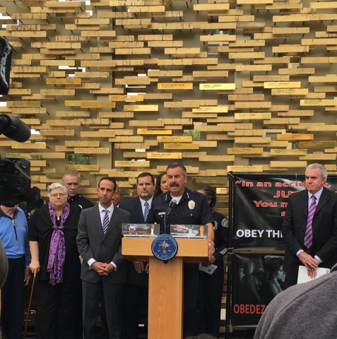"LAPD Chief Charlie Beck, along with Los Angeles City Councilman Mitchell Englander, actress Anne-Marie Johnson and others join to launch ""Obey the Rules of the Road"" billboard campaign. (Photo: Business Wire)"