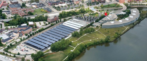 Constellation's 2.4-megawatt solar generation project, pictured during construction, at Owens Corning's headquarters in Toledo. Located above 935 parking canopy spaces, the solar installation is currently one of the largest of its kind in the Midwest and supports Owens Corning's newly expanded sustainability and renewable energy goals. (Photo: Business Wire)