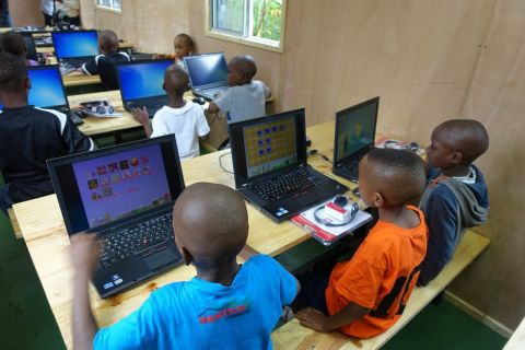 The children of the Tuleeni Orphanage working on the computers in their new mobile classroom. (Photo: Business Wire)