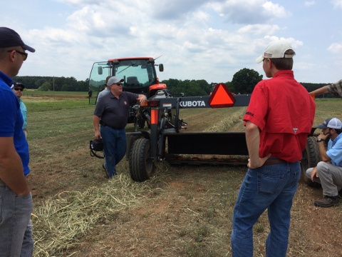 Kevin Cobb, Senior Product Training Manager for Kubota, discusses hay equipment and harvest techniques with University of Georgia, Athens, county extension agents. (Photo: Business Wire)