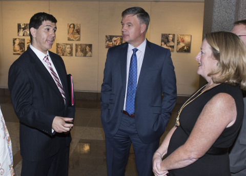 Roman Baca (left), Marine, Iraq War veteran and artistic director of the Ballet Theatre Company (BTC), talked about his work with Jim Bedard (center), CFO of UnitedHealthcare Northeast, and Cathy Malloy (right), CEO, Greater Hartford Arts Council, at a reception for the Greater Hartford Arts Council's 2016 Arts + Wellness Grants recipients. BTC will compose a ballet thematically derived from the military experience. Connecticut-area veterans will have input into music, costuming, staging and choreography for the culminating ballet in autumn 2016. Three other local arts organizations also received grants, supported by UnitedHealthcare, to produce programs that use creativity to enrich lives and enhance the health and well-being of veterans and their families (Photo: Alan Grant, Digital Creations).