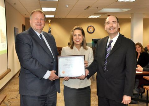 (L to R) John Quackenbush, Chairman, Michigan Public Service Commission; Diane Mills, Sr. Account Ex ...
