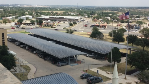 Parking canopies composed of SolarWorld solar panels stand as part of a new solar system at the West Texas VA Health Center in Big Spring. (Photo: Business Wire)