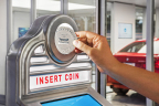 Insert a Carvana-branded coin into the Vending Machine slot and watch it come to life, delivering your car from the Tower to you in seconds. (Photo: Business Wire)