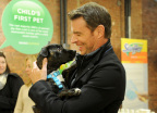 Scott Foley partners with Swiffer to spread the word that cleaning concerns should never be an obstacle to bringing home your child's first pet, Thursday, Nov. 12, 2015, in New York. Foley joined Swiffer and Bark & Co. to provide 10,000 Welcome Home Kits, including free Swiffer products, to shelters nationwide this holiday season. (Photo by Diane Bondareff/Invision for Swiffer/AP Images)