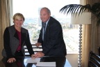 Joel Singer, CEO of zipLogix, and Beth Young, vice president, realty segment for Stewart, sign strategic partnership agreement at the National Association of REALTORS Conference in San Diego, CA. (Photo: Business Wire)