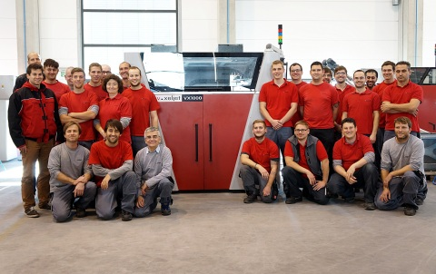 The voxeljet team is pleased with the 100th installed 3D printing system: a VX1000. (Photo: Business Wire)