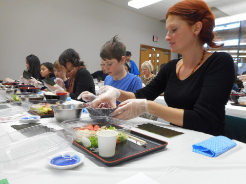 People enjoy cooking Sushi by themselves (Photo: Business Wire)