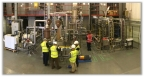 NNL and Kurion teams inspect GeoMelt® system during cold commissioning (Photo: Business Wire)