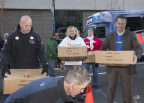 A LAZ Parking volunteer (left) unloaded turkeys donated by the company with UnitedHealthcare, Optum and Bank of America volunteers. More than 1,200 families in Hartford and Tolland counties will be able to sit down to Thanksgiving dinner thanks to the generosity of Hartford employers and residents who stopped by 185 Asylum St. to drop off turkeys and other holiday food items, and donate money for additional meals. The food will be distributed to families in Hartford and Tolland counties who requested assistance in preparing their holiday meals. Foodshare will continue to collect and distribute food for Thanksgiving until Tuesday, Nov. 24. For more information on how to help, or for a list of food donation sites, visit www.aturkeyand30.org (PHOTO: Alan Grant, Digital Creations).