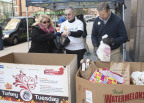 Laura Sullivan and Roman Uzdejczyk of Optum and Craig LaFiandra of UnitedHealthcare, both UnitedHealth Group companies (left to right), sort food donated by Hartford employers and residents who stopped by 185 Asylum St. to drop off turkeys and other holiday food items, and donate money for additional meals. The food will be distributed to more than 1,200 families in Hartford and Tolland counties who requested assistance in preparing their holiday meals. Foodshare will continue to collect and distribute food for Thanksgiving until Tuesday, Nov. 24. For more information on how to help, or for a list of food donation sites, visit www.aturkeyand30.org (PHOTO: Alan Grant, Digital Creations).
