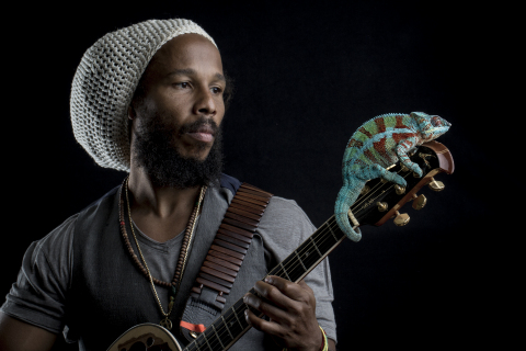 Ziggy Marley with a Panther Chameleon - Photo Credit: Robin Moore, Global Wildlife Conservation