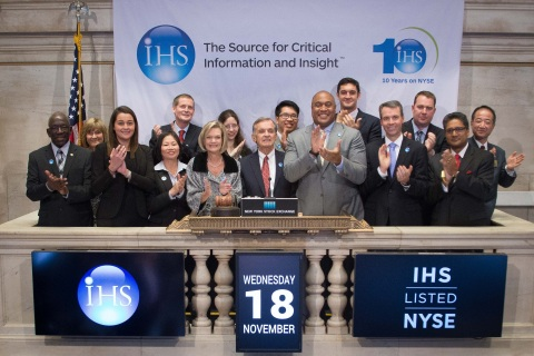 IHS BELL RINGING -- Leaders of business information provider IHS Inc. (NYSE: IHS) today celebrated the 10th anniversary of the company's initial public offering by ringing the closing bell at the New York Stock Exchange. Pictured left to right are IHS colleagues Tommy Moore, Sherry Conca, Silvia Rey Gomez, Grace Au, Todd Hyatt, Vicki Knauf, Joanna Isaac, CEO and Chairman Jerre Stead, Shaun Lee, Garvis Toler III (of NYSE), Paul Campbell, Jonathan Gear, Bill Eager, Anurag Gupta and Yashima Yuko. (Photo: Business Wire)
