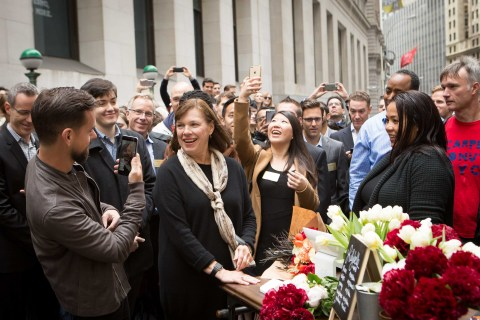 Square CEO Jack Dorsey with his mother Marcia Dorsey outside the NYSE as she makes a purchase from Square's first seller to kick off the NYSE Opening Bell and celebrate the company's IPO. (Photo: NYSE)