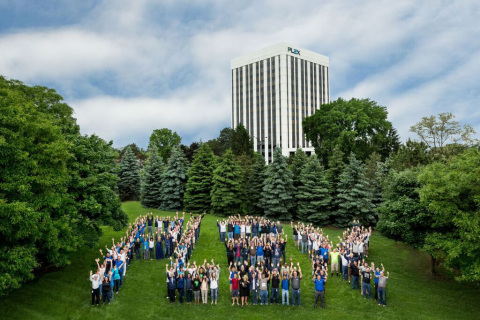 Plex employees in front of the company's Troy, Michigan, headquarters, a Top Workplace according to the Detroit Free Press (Photo: Business Wire)