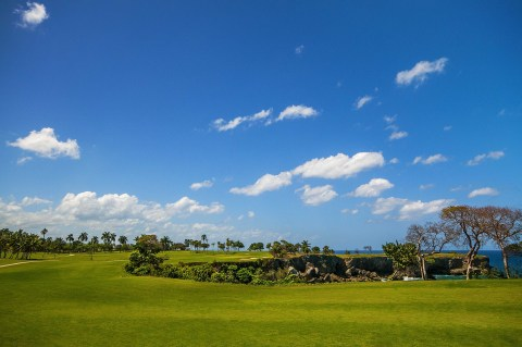 Playa Grande Golf Course in the Dominican Republic hole number 16 par 4 in foreground and hole number 17 green par 3 in the far right on the point. (Photo: Business Wire)