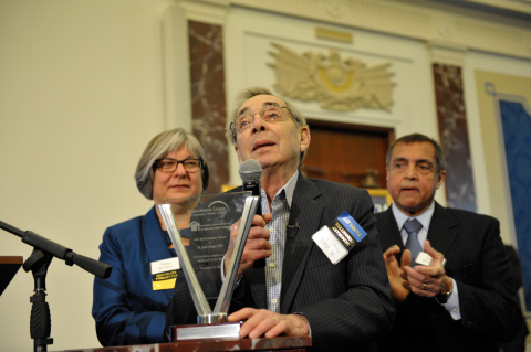 Dr. H. Jack Geiger, co-founder of the first community health center, accepts a Lifetime Achievement Award from the Massachusetts League of Community Health Centers. (Photo: Business Wire).