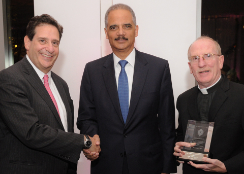 Former U.S. Attorney General Eric Holder (center), with Fordham Law Dean Matthew Diller (left) and Fordham University President Joseph M. McShane, received the Fordham-Stein Prize in a November 18 ceremony at Fordham Law School in New York City. (Photo: Business Wire)