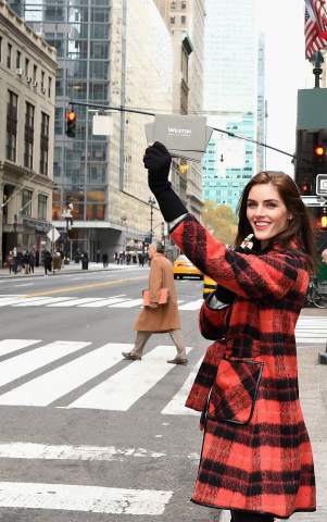 "Model Hilary Rhoda at Grand Central Station Surprised Travelers with a ""Holiday After the Holiday"" by Westin Hotels & Resorts (Photo: Business Wire)"