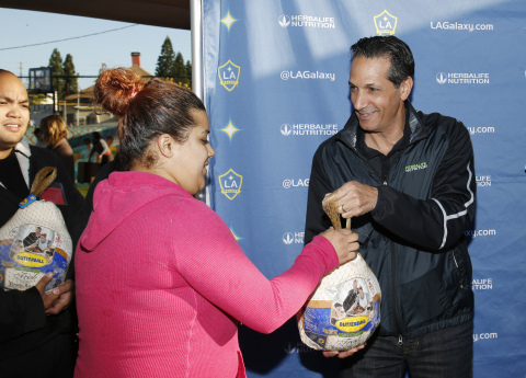 Herbalife Executive Vice President Rob Levy helps hand out more than 500 turkeys and groceries as the Herbalife Family Foundation and the LA Galaxy Foundation partner with A Place Called Home to provide Thanksgiving meals. Nov. 25, 2015, in Los Angeles. (Photo: Business Wire)