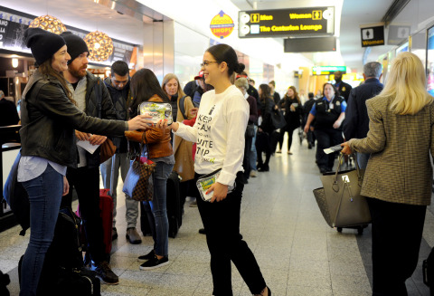 """Homewood Suites and Home2 Suites by Hilton distribute stress relieving """"suite travel"""" kits to travelers departing from New York's LaGuardia Airport on the day before Thanksgiving (Photo by Diane Bondareff/AP Images for Homewood Suites by Hilton)"""