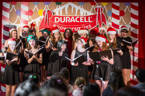 "Carly Rae Jepsen carols with the Etobicoke School of the Arts Women's Chorus at The Hospital for Sick Children (SickKids) in Toronto to celebrate the launch of the Duracell ""Powering Holiday Smiles"" program. For every pack of Duracell batteries purchased at Walmart Canada November 25th to December 31st 2015, Duracell will donate to Children's Miracle Network, with the goal to raise $100,000. (Photo: Business Wire)"