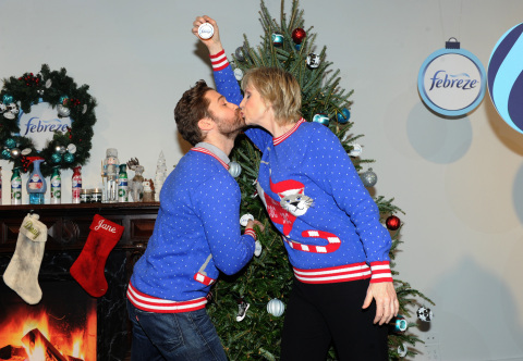 "Jane Lynch and Matthew Morrison share a kiss under the ""Mistletoe"" as they host the Febreze #12Stinks of Christmas Party, Monday, Nov. 30, 2015 in New York, where they unveiled ""The #12Stinks of Christmas"" video, a parody on the classic holiday tune. Febreze eliminates stinks in a merry way, keeping hosts guest-ready all season long. The video, starring the duo, is available now on the brand's YouTube channel. (Photo by Diane Bondareff/Invision for Febreze/AP Images)"