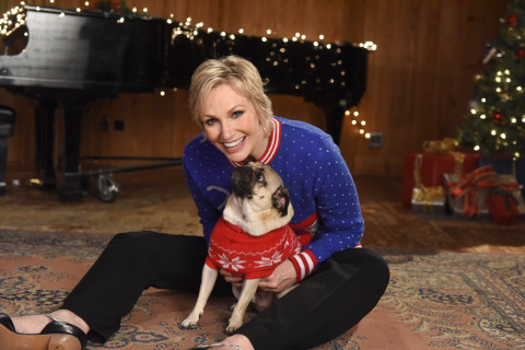 "In this photo released Monday, Nov. 30, 2015, Jane Lynch poses with Doug The Pug while filming ""The #12Stinks of Christmas"" video, a parody on the classic holiday tune, unveiled today at the Febreze #12Stinks of Christmas Party in New York. Febreze eliminates stinks in a merry way, keeping hosts guest-ready all season long. The video, starring Jane Lynch, Matthew Morrison and Doug The Pug, is available now on the brand's YouTube channel. (Photo by Diane Bondareff/Invision for Febreze/AP Images)"
