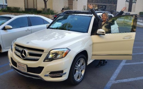 Michelle E. from North Hollywood, CA shows off the Mercedes she bought from Car Harmony. (Photo: Bus ...