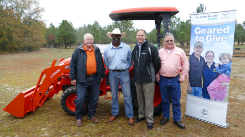 Left to right: Charlie McCullen, Cumberland Tractor Company; Marvin Frink; Alex Woods, Kubota vice president divisional operations; Michael O'Gorman, FVC executive director. (Photo: Business Wire)