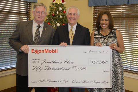Exxon Mobil Corporation Chairman and Chief Executive Officer Rex W. Tillerson presents the company's annual chairman's gift of $50,000 to Jonathan's Place, kicking off the organization's 25th anniversary on Tuesday, Dec. 8, 2015, in Garland, Texas. Pictured left to right: Garland Mayor Douglas Athas, Rex W. Tillerson, and Allicia Frye, chief executive officer of Jonathan's Place. (Photo: Business Wire)