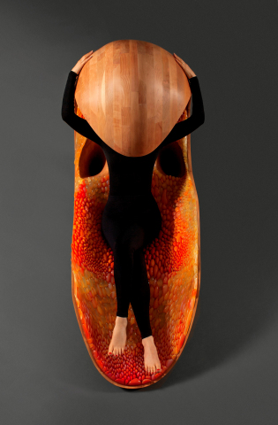 'Gemini' acoustic chaise by Prof. Neri Oxman in collaboration with Prof. W. Craig Carter and STRATASYS, purchased by SFMOMA. Inner lining produced in 44 composite materials using Stratasys' unique color, multi-material 3D printing technology.  Photography by Michel Figuet