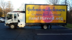 'No More Tears for J and J Greed!' mobile billboard will circulate around the Johnson & Johnson headquarters in New Brunswick, NJ to protest the company's $5.8 million donation to oppose a CA drug pricing relief ballot measure. More info at jandjgreed.org (Photo: Business Wire)