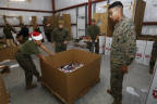 A team of marines unloads and sorts one of the 22 pallets of books, toys and games that Barnes & Noble donated to Toys for Tots in New York City (Photo Credit: Jeff Zelevansky for Barnes & Noble).