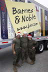 The job is never done for our bravest men and women, but they took a moment to celebrate the unloading of Barnes & Noble's donation (Photo Credit: Jeff Zelevansky for Barnes & Noble).