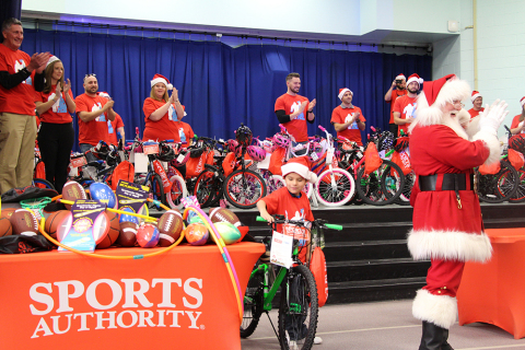 Sports Authority and the USS Foundation Surprise 100 Denver Children with Bikes and Helmets. (Photo: Business Wire)