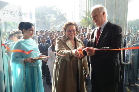 Executive Administrator Abeer Khan assists with the ribbon cutting as Chief Human Resources Officer Johnna Torsone and CEO Marc Lautenbach officially open the new Pitney Bowes office in Gurgaon, India. (Photo: Business Wire)